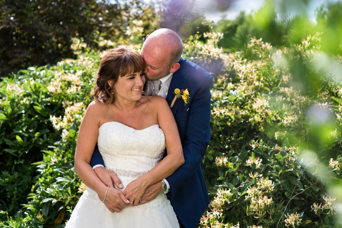 Photograph of Debbie and Martin in the gardens balding after their wedding ceremony