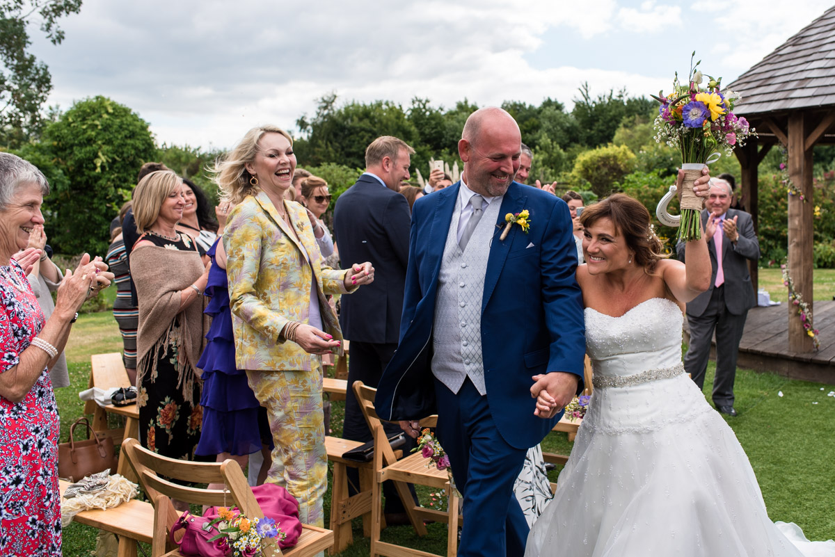 The Garden Yalding wedding photography. Debbie and Martin as they walk back down the aisle
