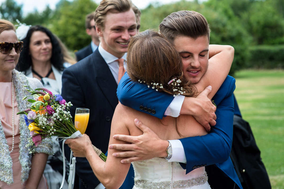 Debbies son congratulates her after her wedding ceremony in Kent