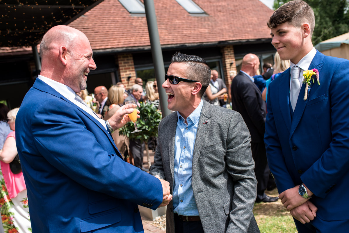 Photograph of wedding guest congratulating Martin after his wedding at The Gardens Yalding in Kent