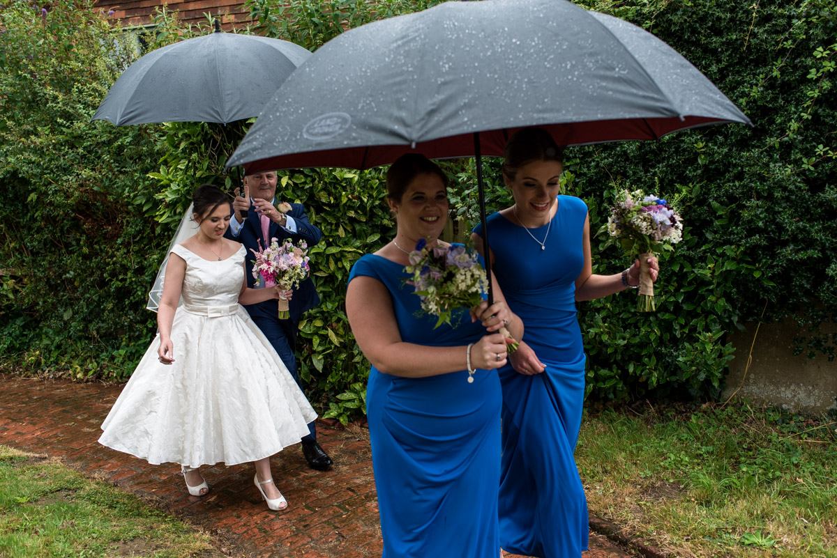 Emily and her bridesmaids photographed arriving for church wedding