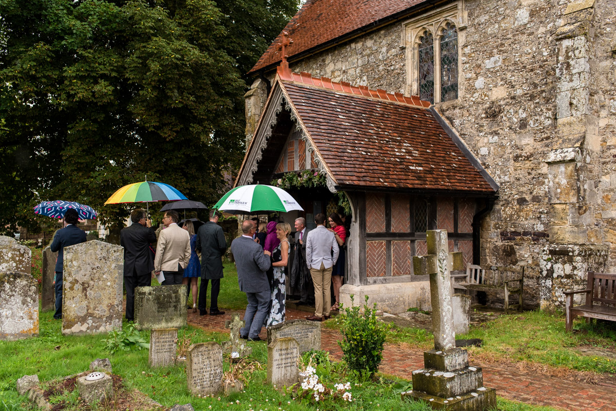 Photograph of wedding guests outside east sussex church
