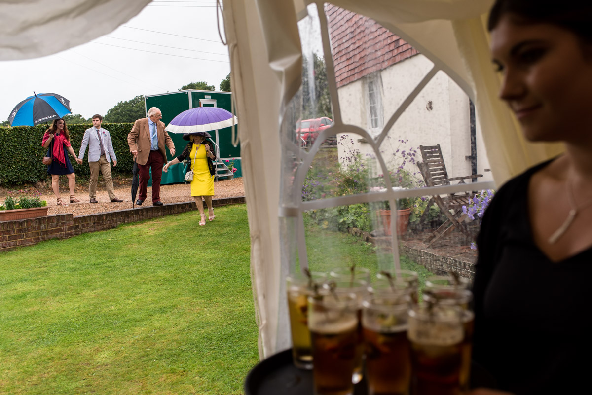 Wedding guests photographed making their way to marquee