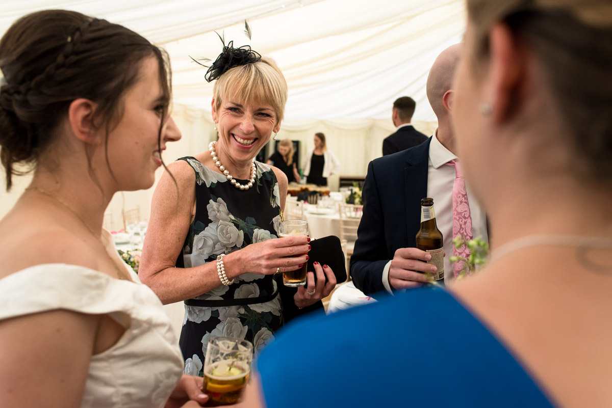 Photograph of Emily talking to wedding guests
