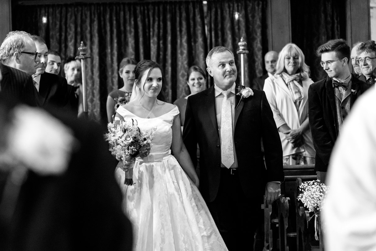 Emily and her dad photographed walking down aisle on her wedding day