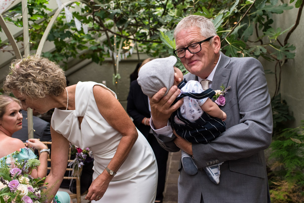 Photograph of John and his grandson after wedding ceremony at The Secret garden