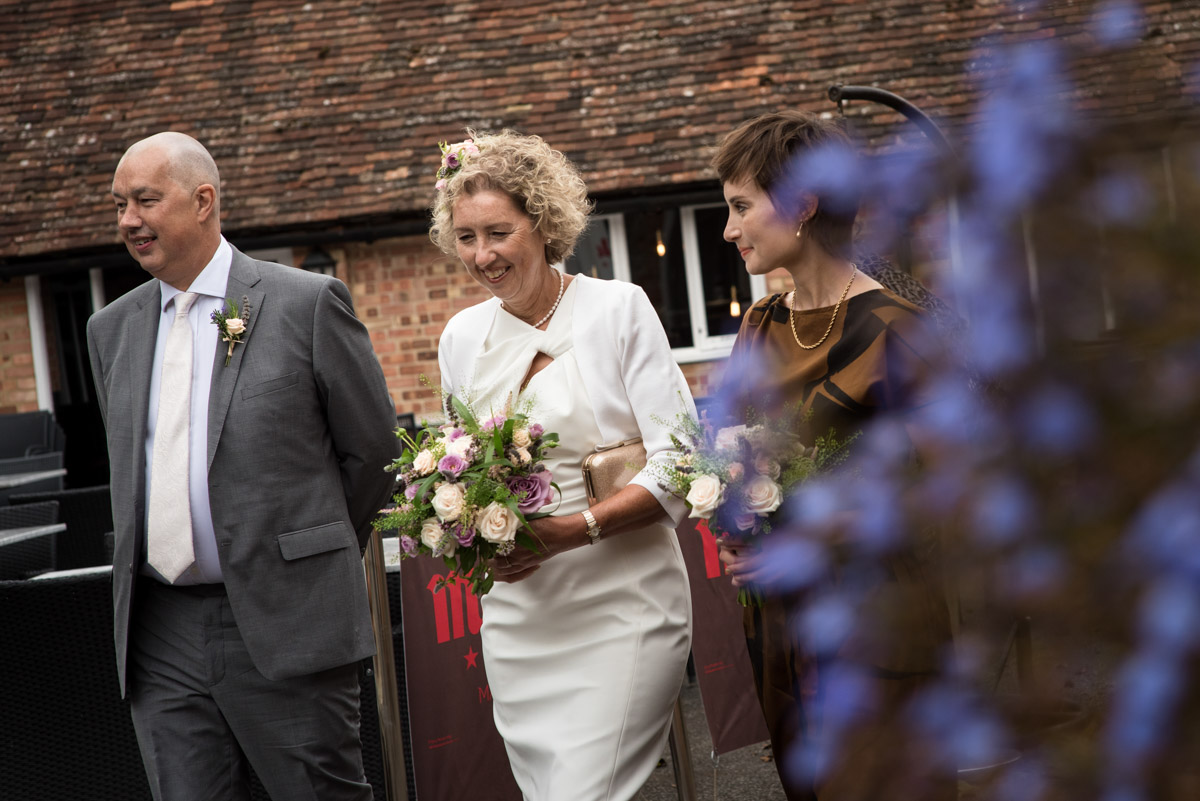 The Secret garden wedding photography, Kate walking with her brother and daughter