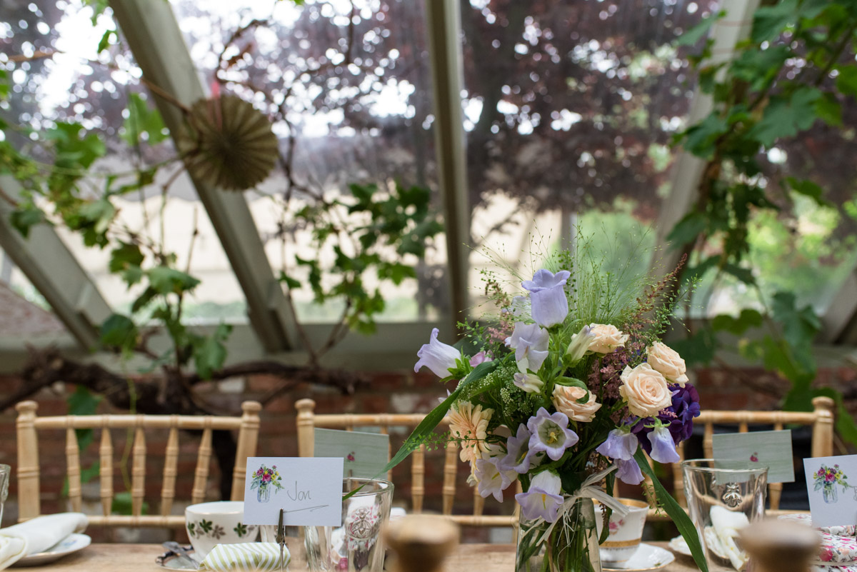 Photograph of table decorations in the Glass House at the Secret garden in Kent