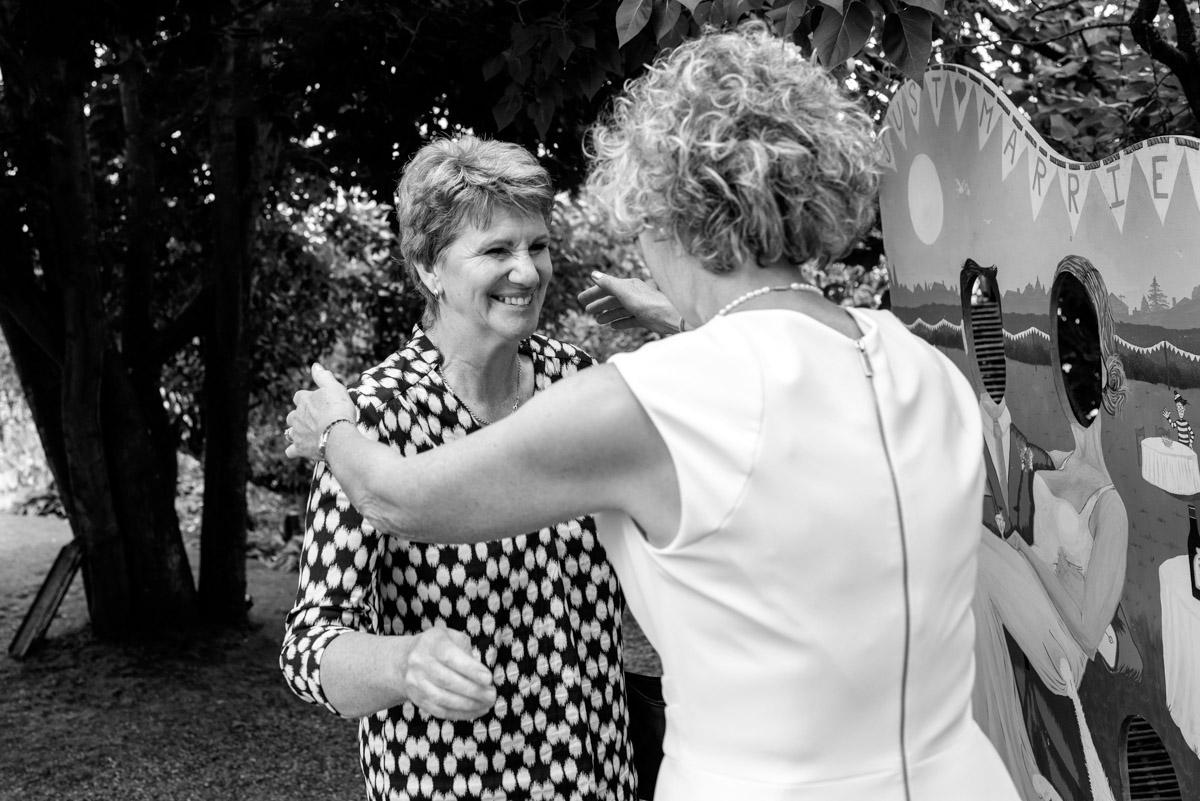 Kate hugs wedding guest