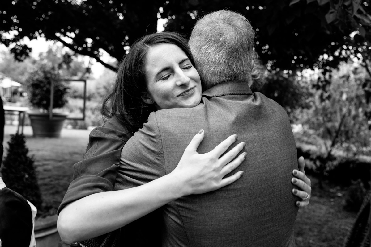 wedding guest is photographed hugging John