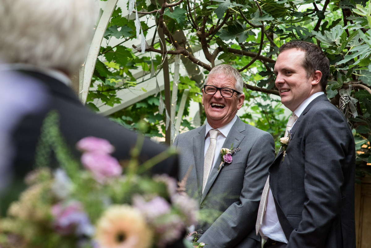 Photograph of John and his best man in The Glass House at The Secret garden wedding venue