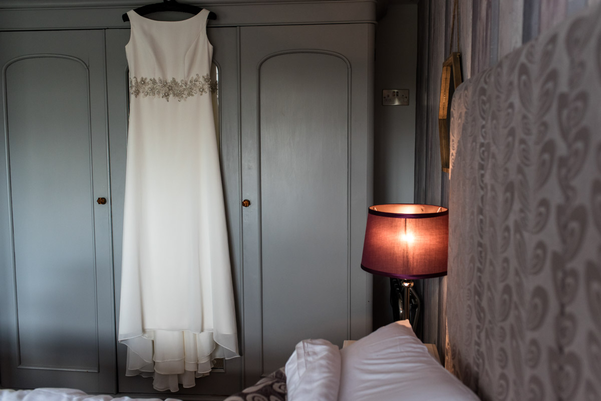 Photograph of wedding dress hanging up at Crescent turner Hotel