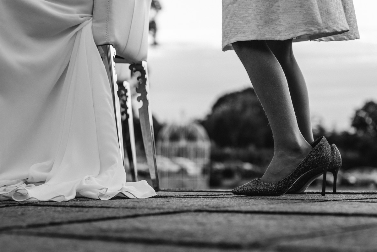 Photograph of bridesmaid wearing brides wedding shoes