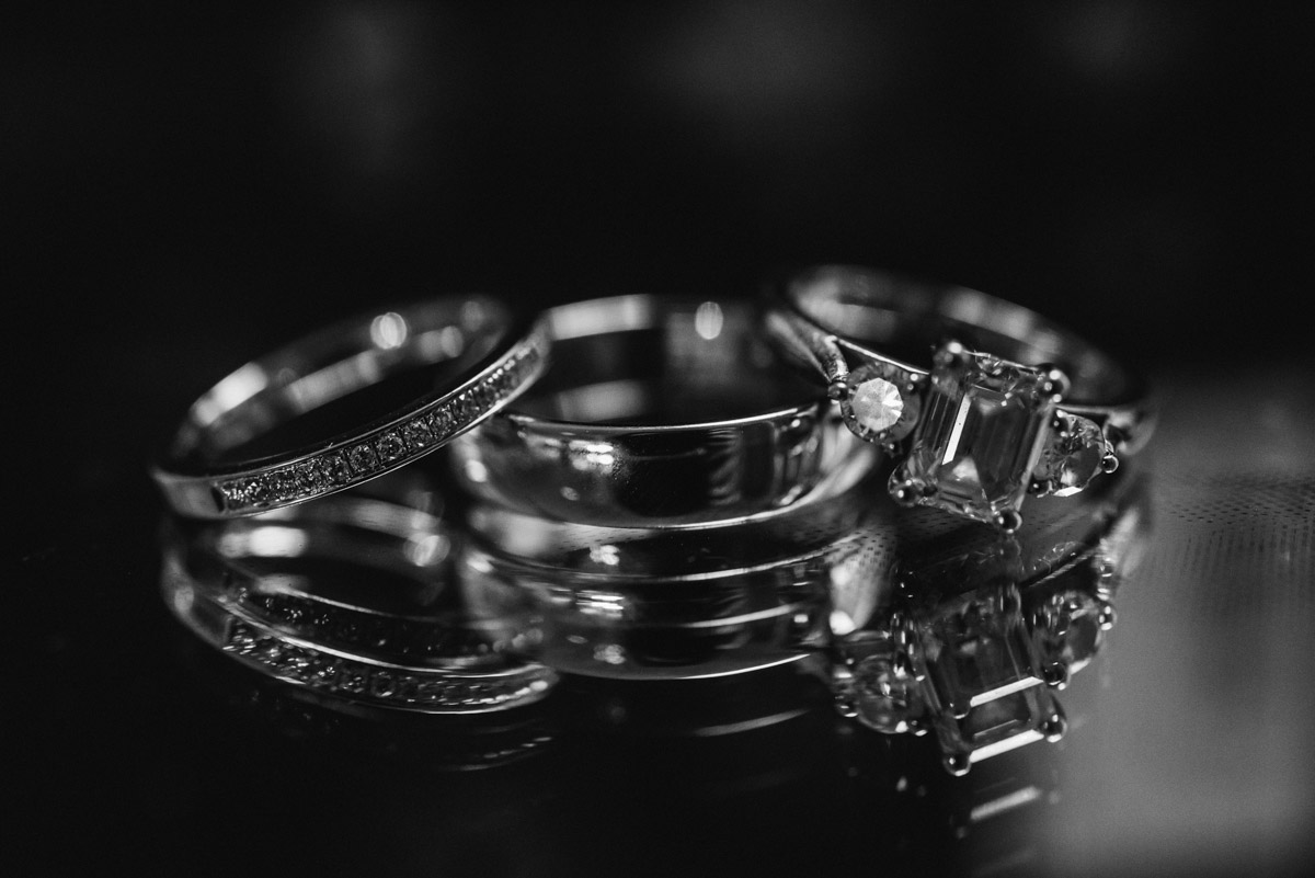 Black and white photograph of wedding rings