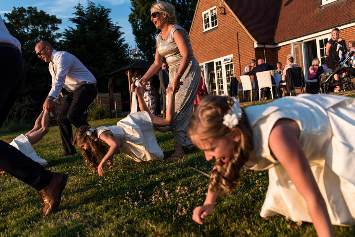 Photographs of wheel barrow racing at Crescent turner Hotel wedding