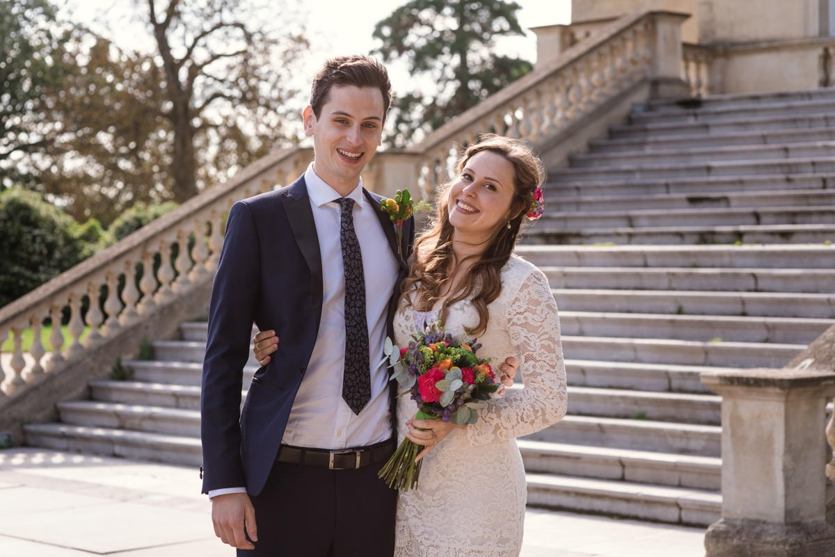 Photograph of Alex and James outside Danson House wedding venue in Kent