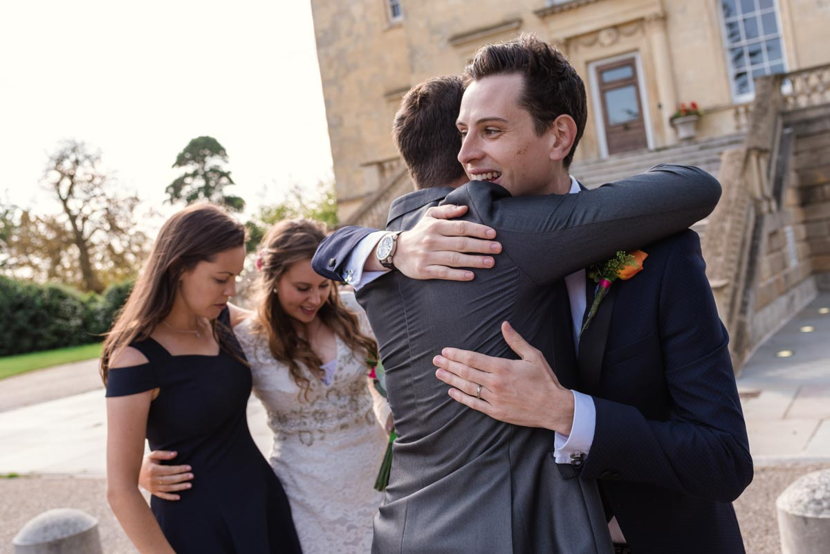 Photograph of Alex and James and wedding guests at Danson House in kent
