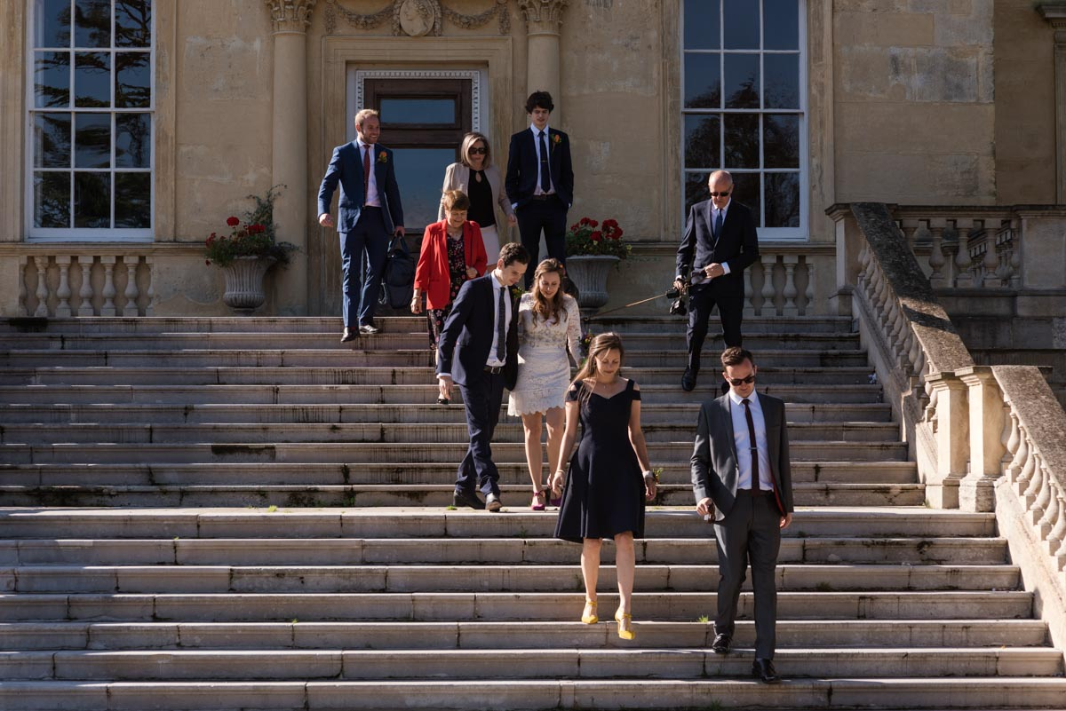 Alex and James with wedding guests outside Danson House in Kent