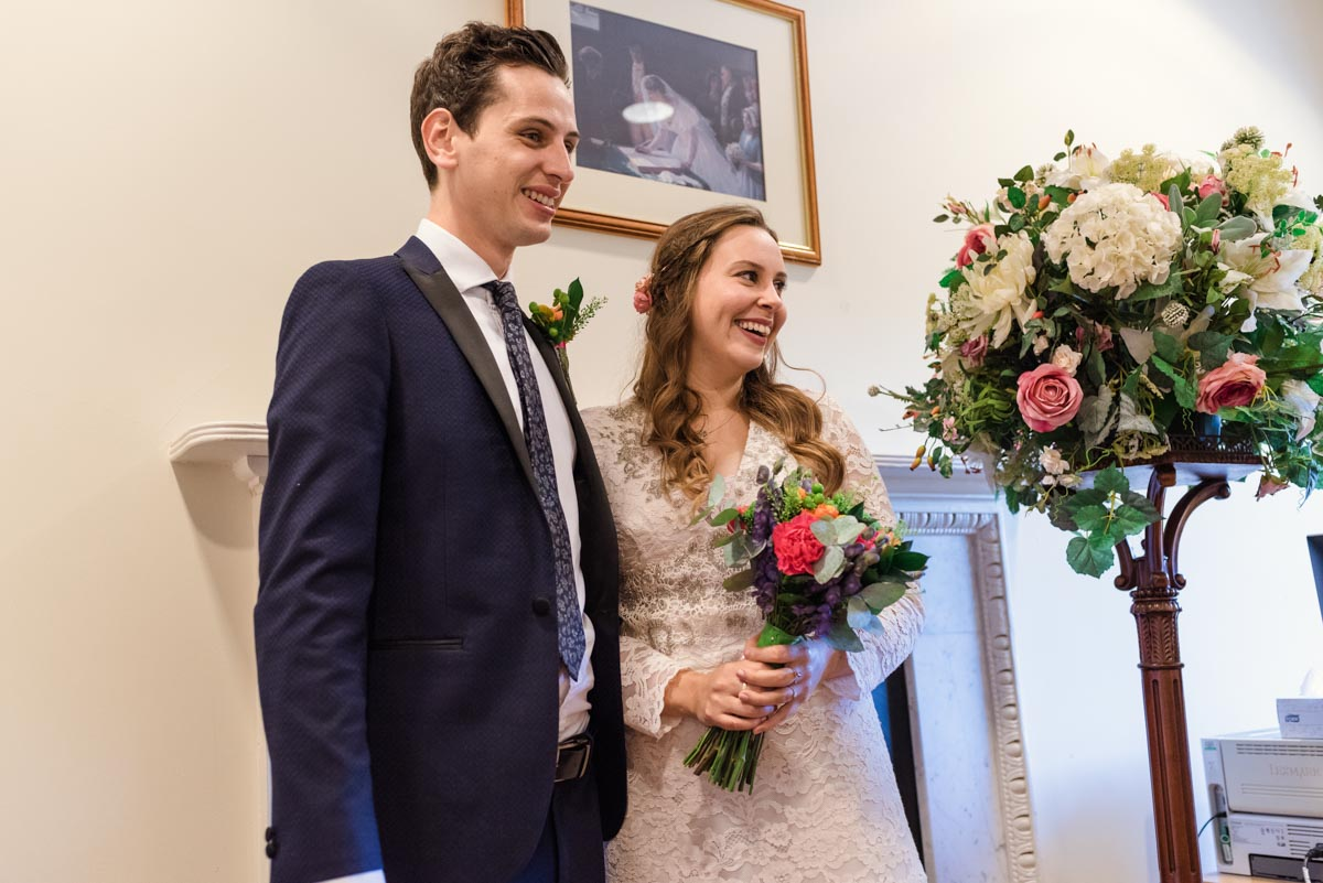 Photograph of Alex and James during their Danson House wedding ceremony
