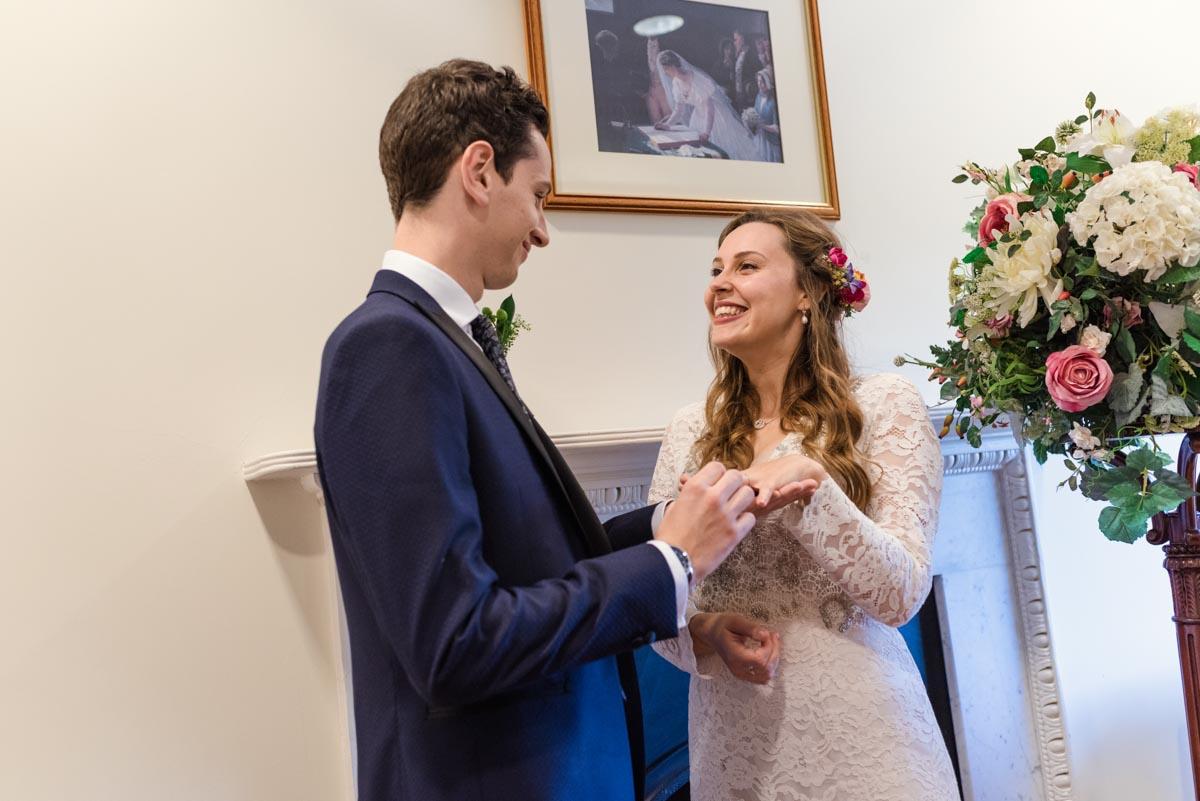 James puts wedding ring on Alexs finger during Danson House wedding ceremony