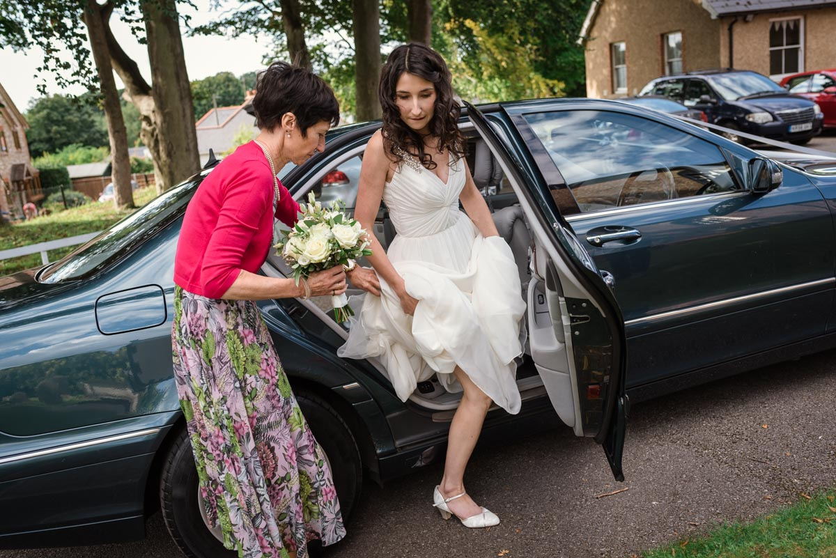 Claire arrives with her mum at Eythiorne Baptist church for her wedding