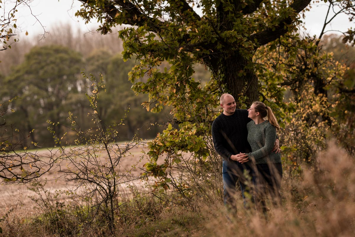 Photograph of Ryan and Rachel walking on the farm at their pre wedding shoot