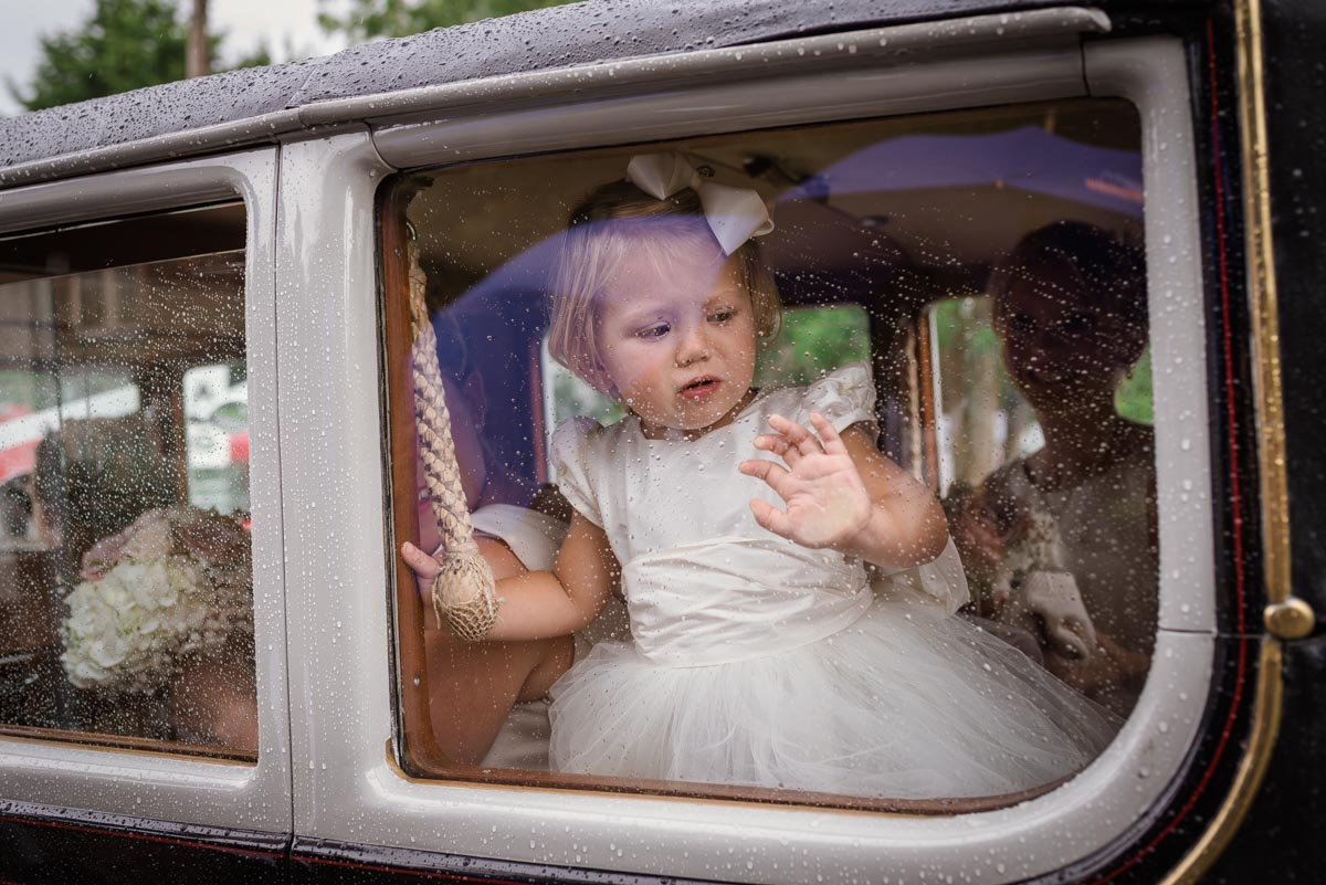 Photograph of flower girl in wedding car