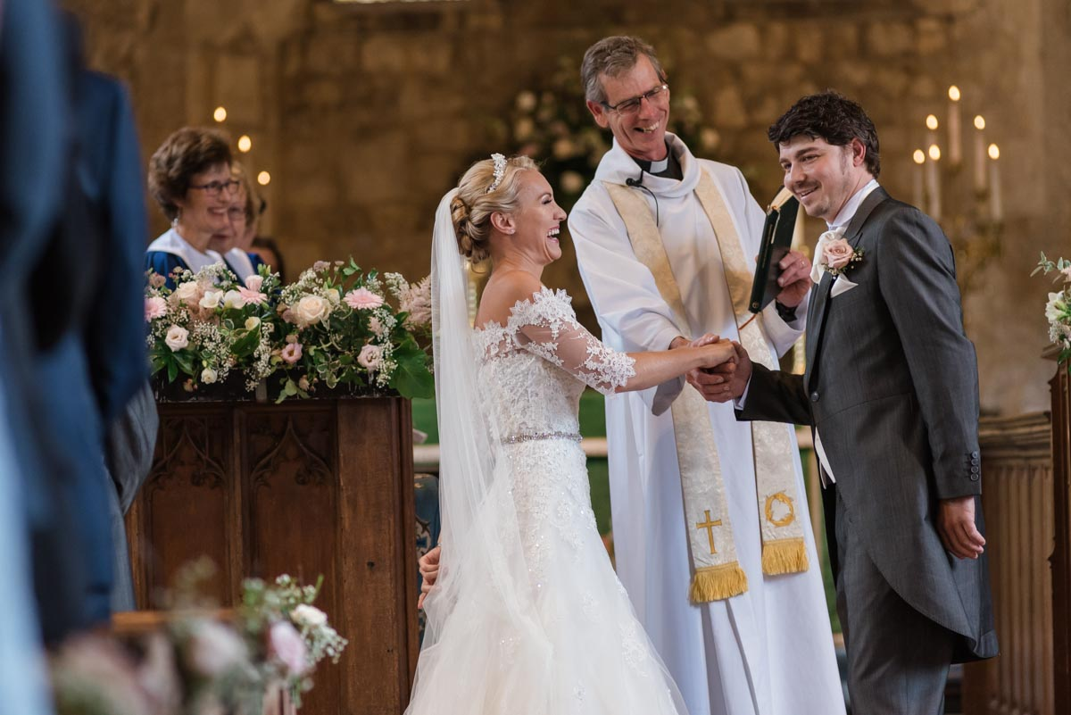 James and Rebecca photographed in Smarten Church on their wedding day