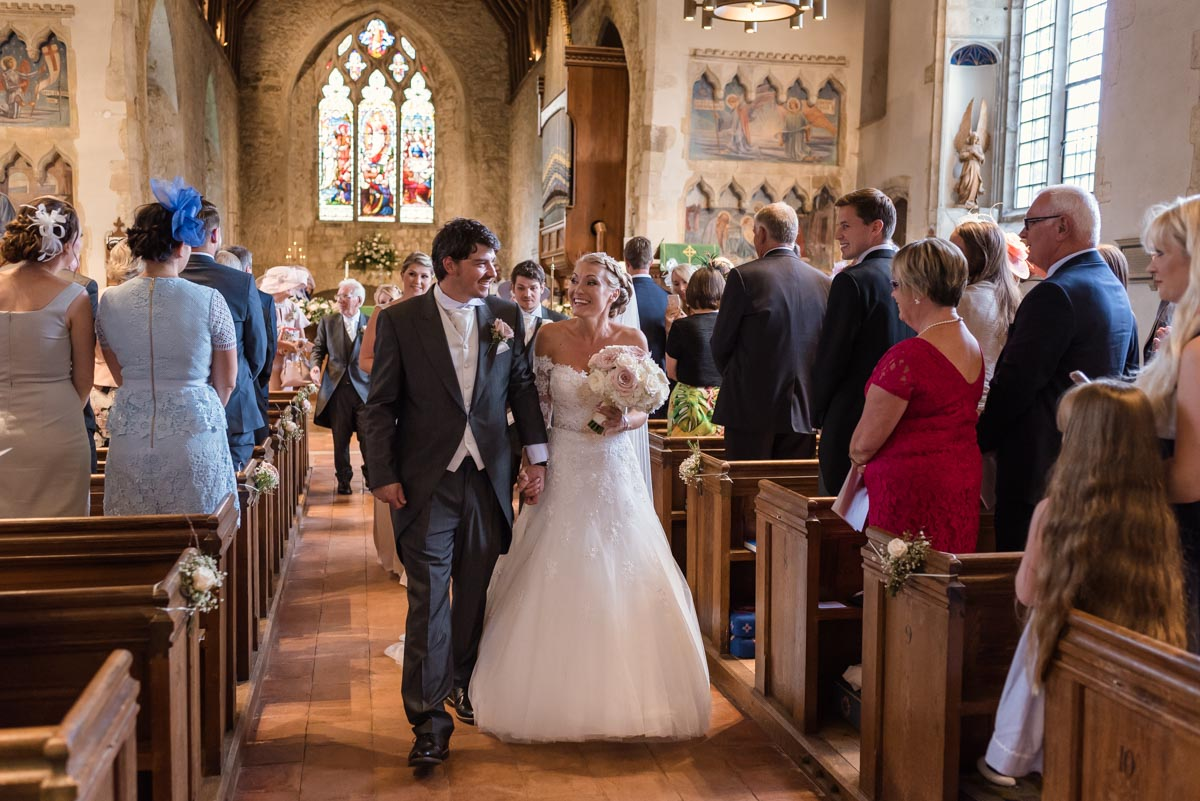Rebecca and James photographed leaving church on their wedding day