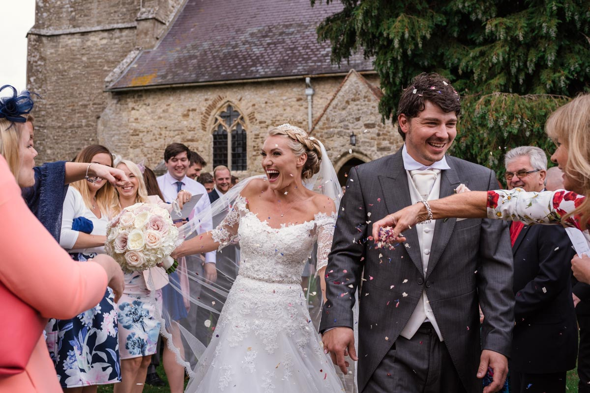 Confetti photograph. Rebecca and james wedding day at Smarten Church in Kent