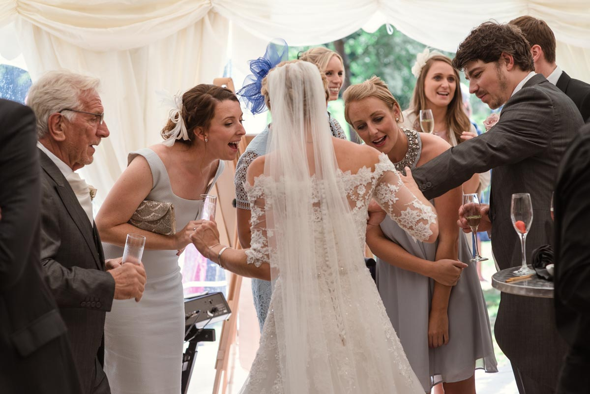 Photograph of guests admiring Rebeccas wedding ring