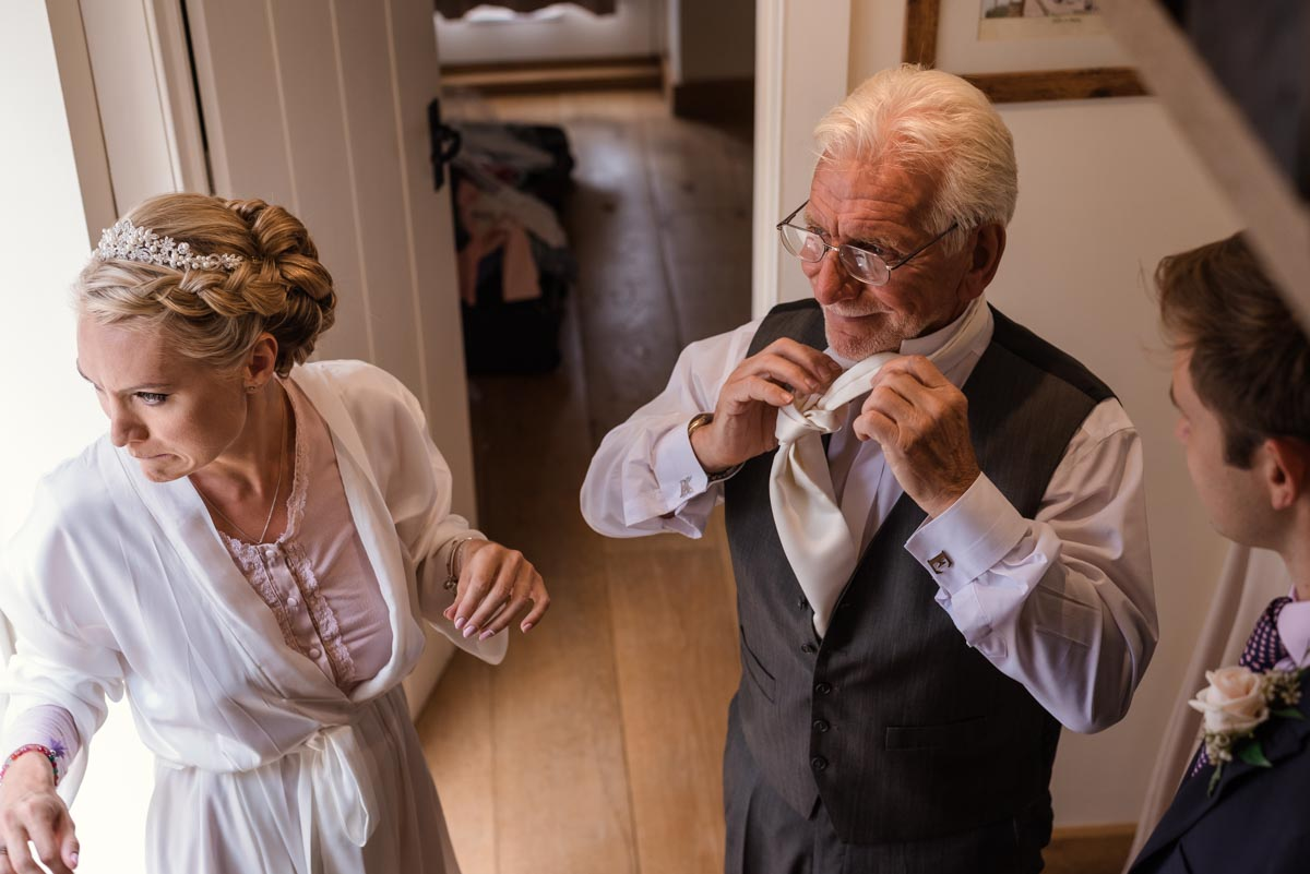 Photograph of Rebecca 7 her dad getting ready before her Smarten church wedding in Kent