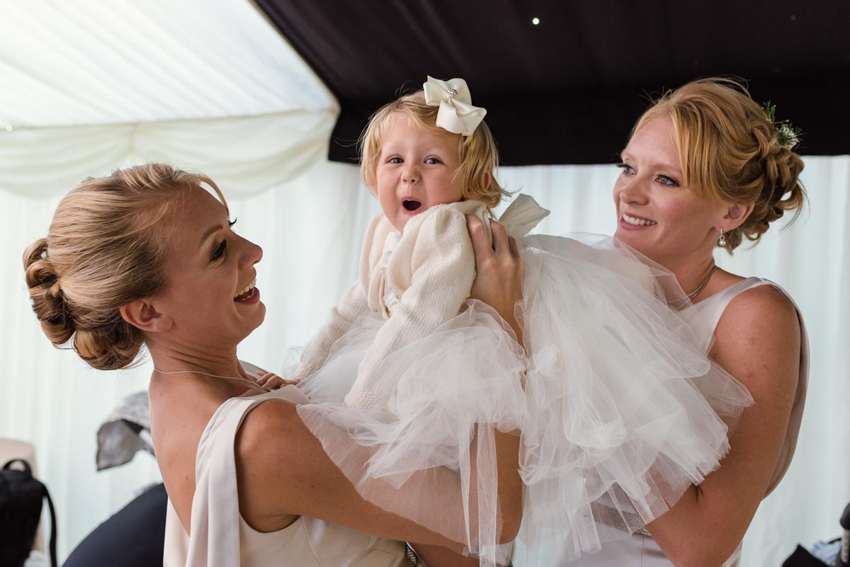 Funny photograph of flower girl and bridesmaids
