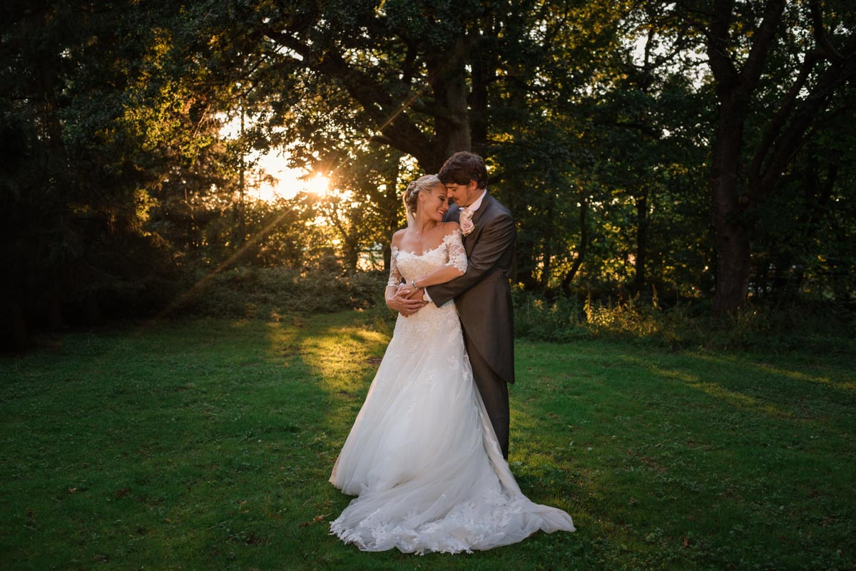 Photograph of James and Rebecca at sunset at their wedding in Kent