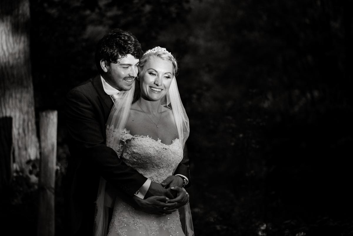 Black and white portrait photograph of James and Rebecca on their wedding day in Kent