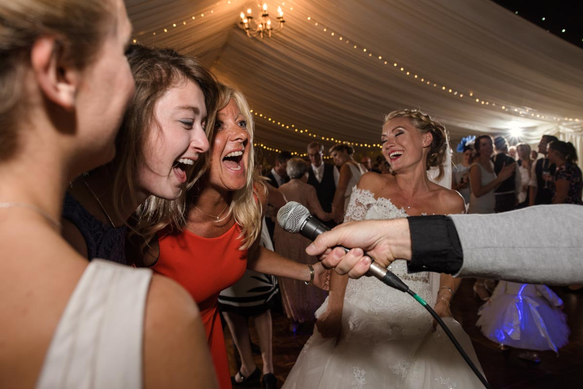 Wedding photograph of guests singing
