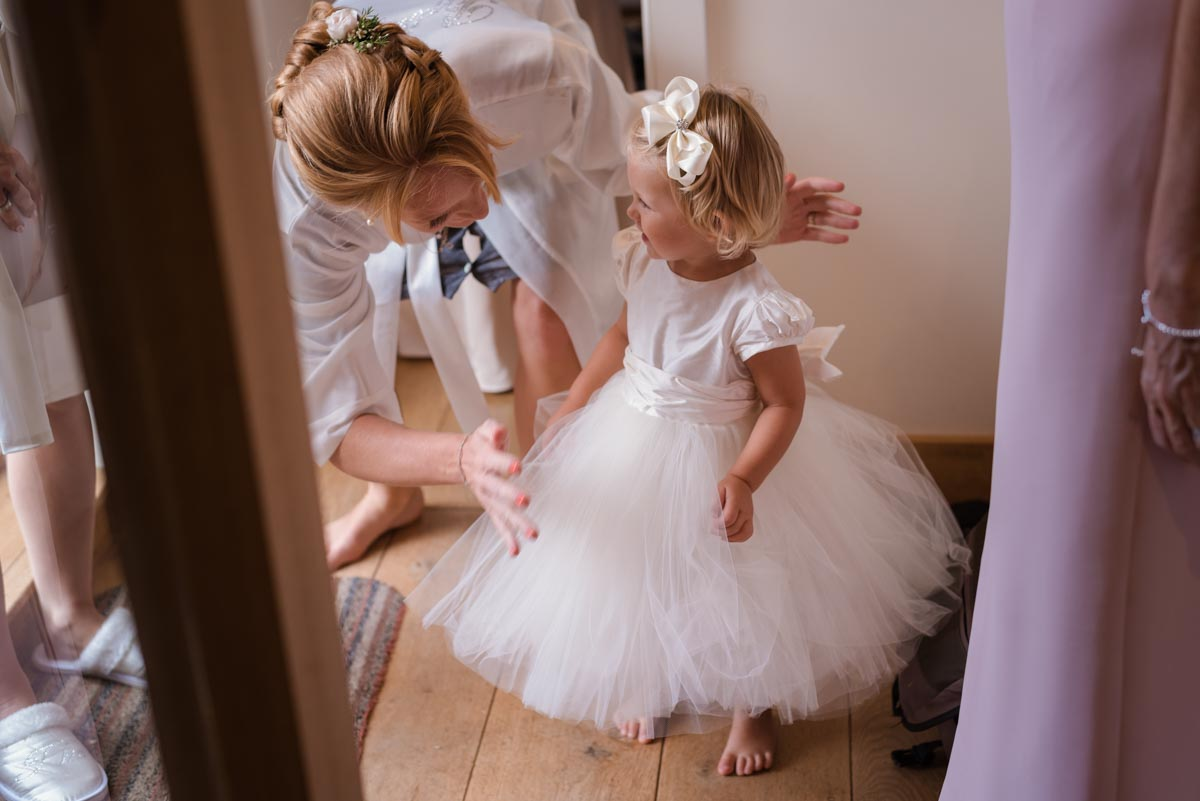Photograph of flower girl before James and Rebecca's Smarten church wedding in Kent