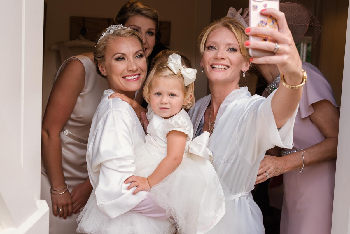 Group selfie of Rebecca and her bridesmaids before her smarden church wedding in Kent