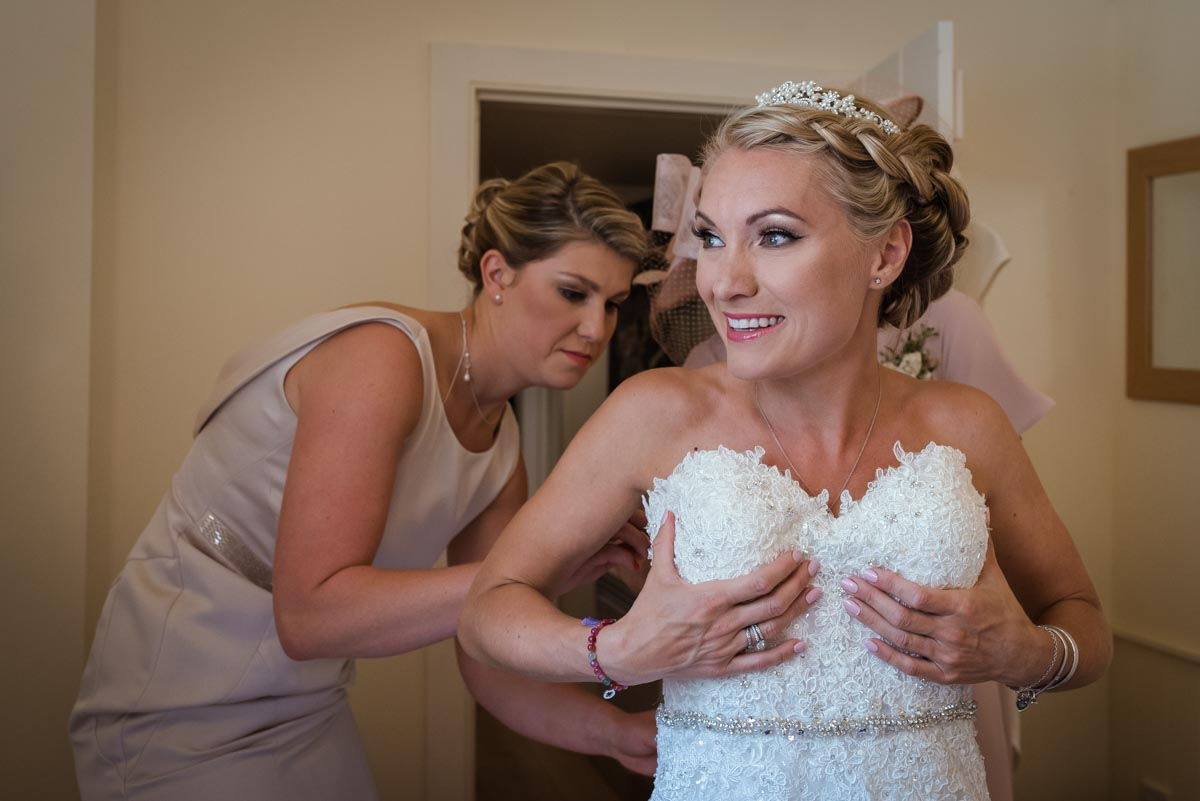 Rebecca is photographed getting her wedding dress on