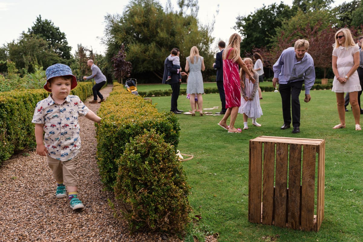 Guests enjoy games at sarah and Chris's wedding at the secret garden
