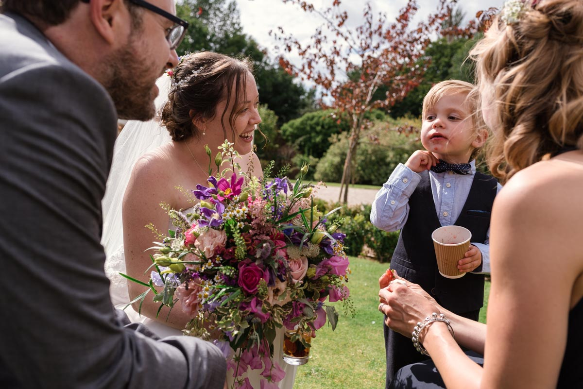 photograph of Chris and Srah talking to their wedding guests