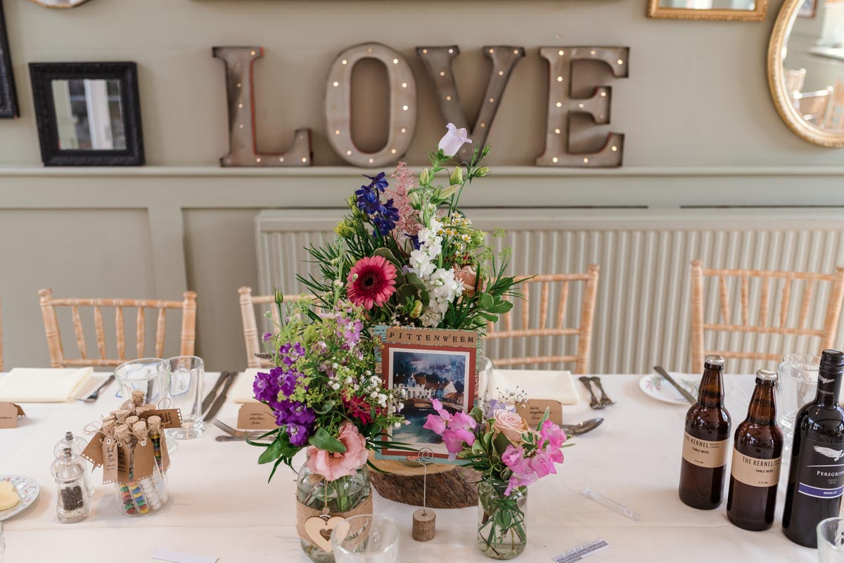 Photograph of table decorations at Sarah and Chris's secret garden wedding in Kent