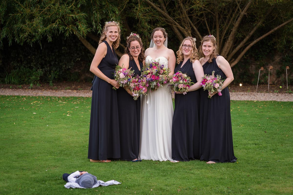 Photograph of sarah and her bridesmaids at her wedding at the secret garden
