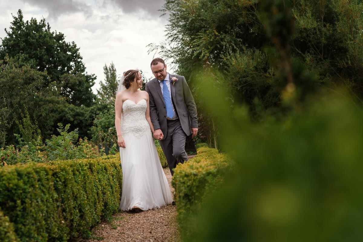 Photograph of sarah and Chris on their wedding day at the secret garden