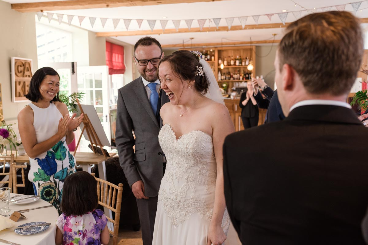 sarah and Chris are welcomed into their reception at the secret garden