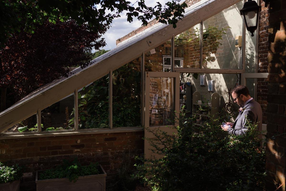 Chris goes over his speech outside the secret garden glass house