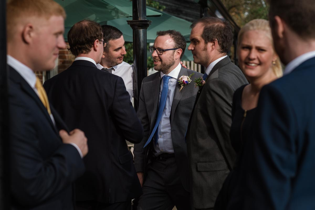Chris is photographed with friends on his wedding day at the secret garden in Kent