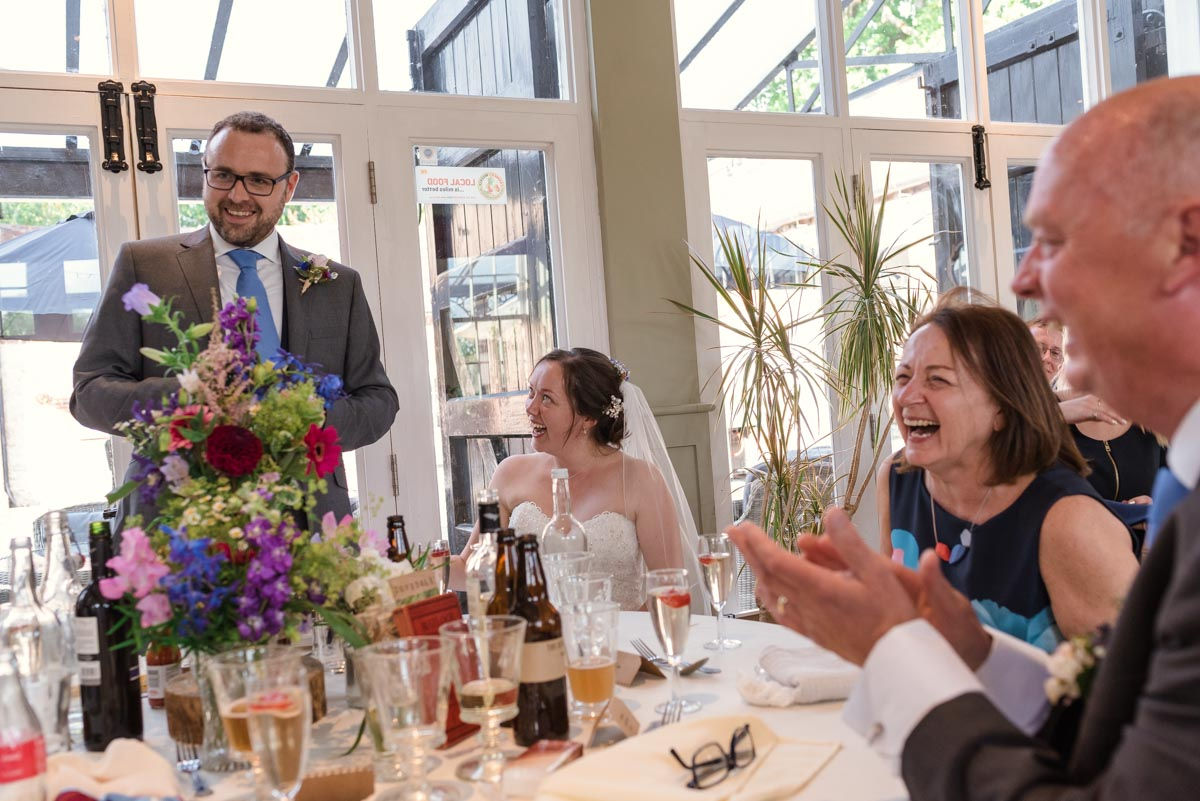 Photograph of chris making his wedding speech at the secret garden in kent