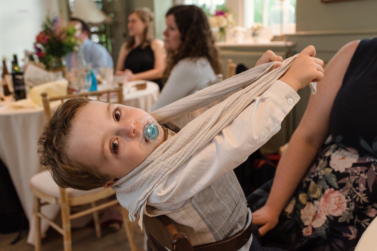Photograph of little boy at sarah and Chris's secret garden wedding reception