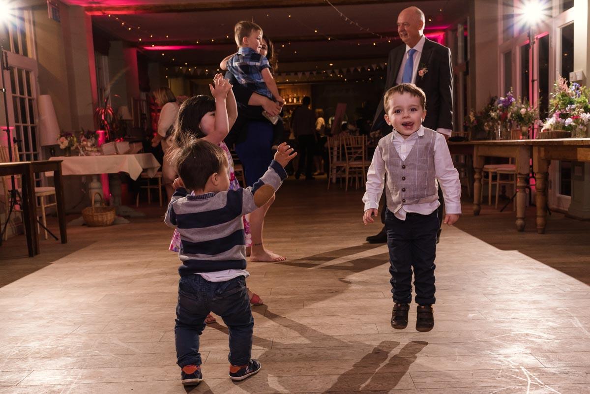 Little children dancing at secret garden wedding reception
